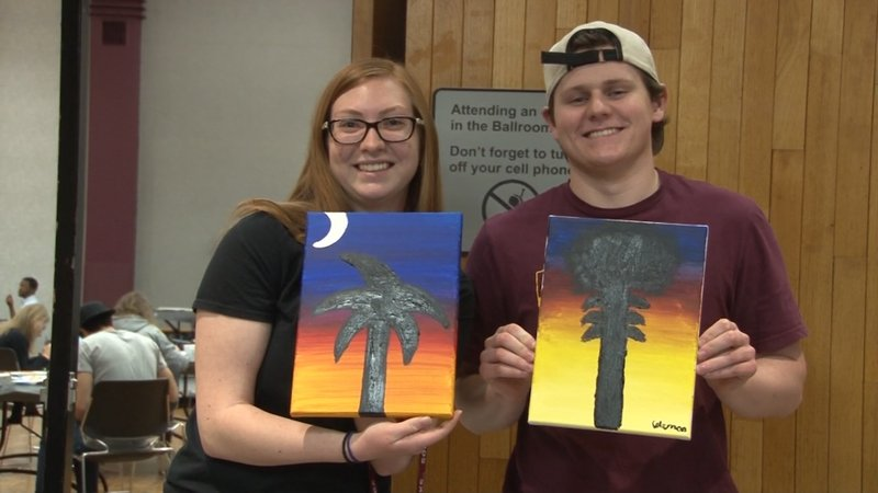 The finished product was a palmetto tree in the shadow of a sunset.
