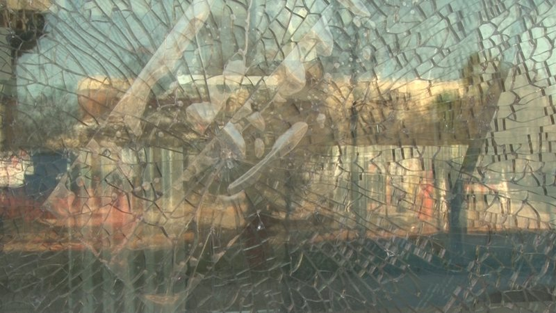 The shattered window at Tropical Smoothie Cafe after BB gun shots were fired.