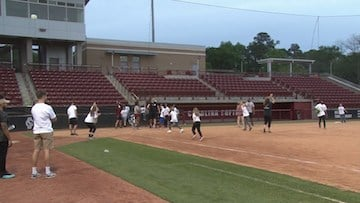 Children and various USC atlethes took to the field to play a no score game of kickball.