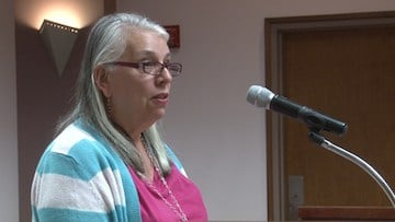 Irmo resident Janie Berks explains to town council members why she wants a lottery system.