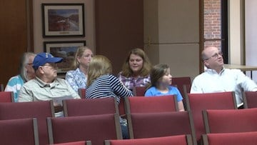 Supporters for backyard hens came prepared to speak to town council members.