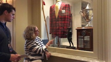 Teresa Norby, long time spectator, looks at an old Heritage outfit and trophy