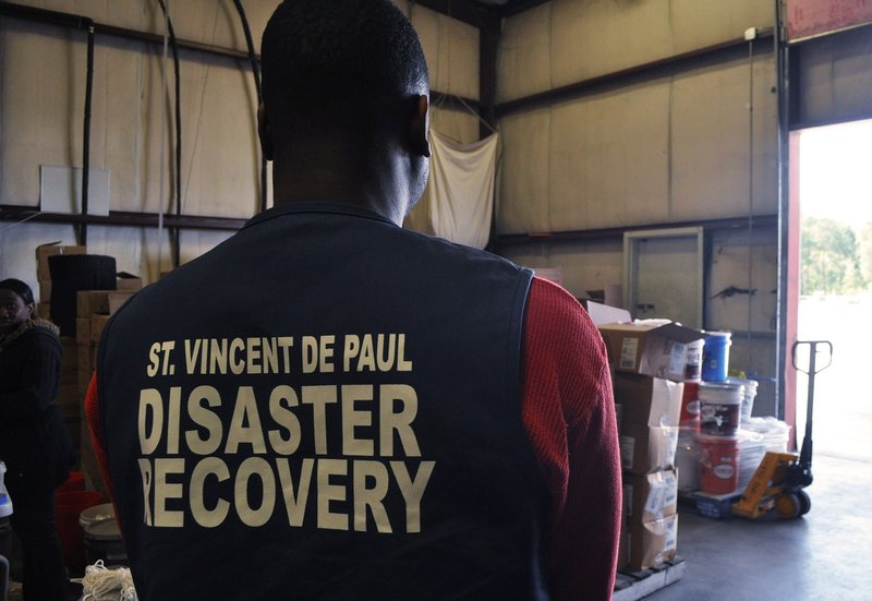Tim James, one of the warehouse workers, takes a short break between organizing flood supplies. The foundation's warehouse off of Shop Road has served approximately 400 families and continues to do so.