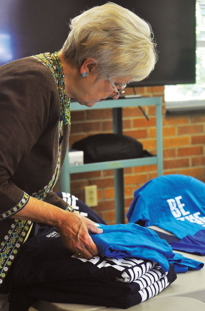 Helen Pridgen, South Carolina area director for the AFSP, sorts shirts for the upcoming Out of the Darkness walk in Columbia. The walk will take place on Oct. 23, 2016, at Boyd Plaza and will raise awareness and funds for suicide prevention research.