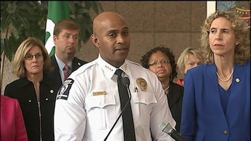 Charlotte Police Chief Kurr Putney told reporters they found a gun and no book at the shooting.