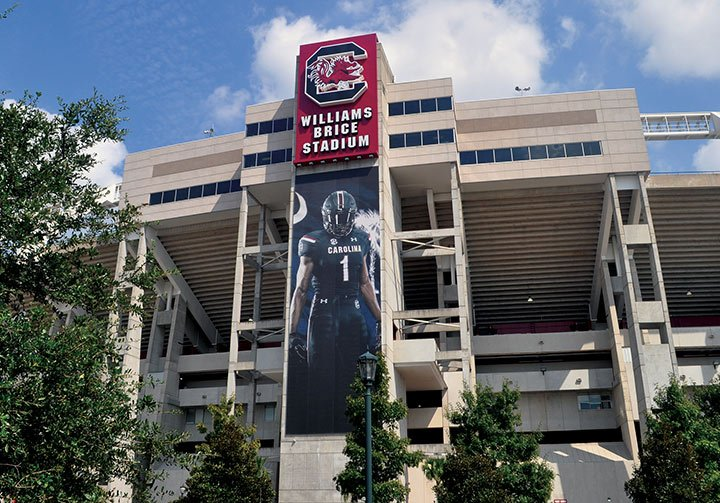 South Carolina receiver Deebo Samuel's multi-story picture greets fans and foes alike outside of Williams-Brice stadium. Gamecocks will see him as a welcome while Aggie fans will enter the stadium for only the second time since Texas A&M joined the SEC.