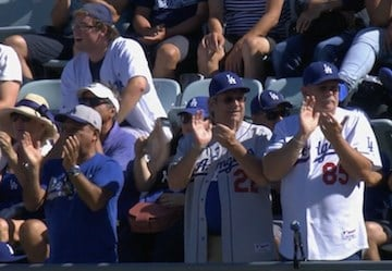 Dodgers fans applaud Vin Scully on Sunday during his final home game as the team's voice.