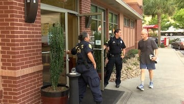Columbia police officers held the doors open for customers.