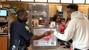 Police officers helped give customers their orders.