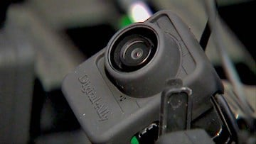 The body cameras automatically activate in particular situations, such as when two officers come in contact or when an officer removes his or her taser from the holster.