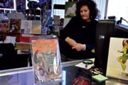 """Ann Hart, owner of the Silver City comic book store in Cayce, with an original """"Amazing Spider-Man"""" No. 2, on sale for $2,000. Hart said if the book were in premium condition, it could fetch as much as $9,000."""