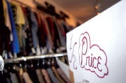 A sale sign sits over a clothing rack at The Gentleman's Closet on Saluda Street in Five Points.  The store offers name brand men's clothes on consignment from local retailers as well as gently used garments. R. Darren Price / The Carolina Reporter