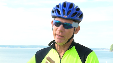 Lexington resident Ralph Mayer rides his bike on the Lake Murray dam and sees the town rebuilding..