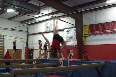 Top level gymnast Victoria Hilliard practices her beam routine.