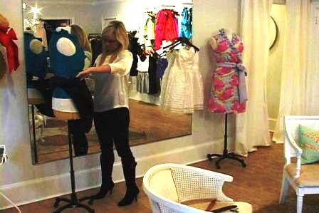 Annabelle LaRoque designs women's clothing at her store in Columbia.