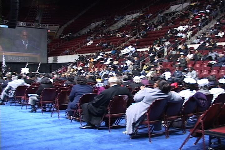 People from all over the country are gathered in the Coliseum, listening to speakers and hoping for change in the black community.