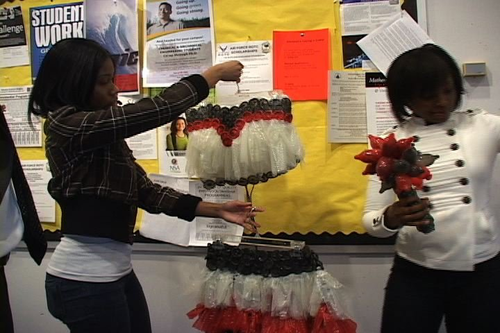 USC student Shiniece Reese taking a look at her condom-designed outfit.