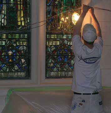 A construction worker at Trinity Episcopal Cathedral works to adjust the portable lighting. Over $7.1 million has been raised to fund the three-year restoration project, though more needs to be raised.