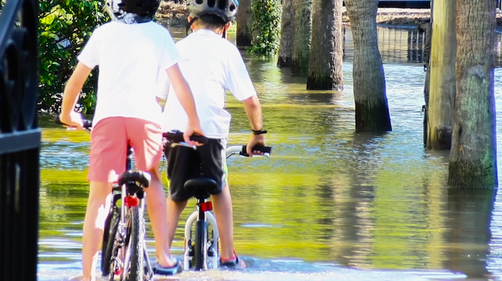 Kids took to their bikes going through two feet of water to get home.