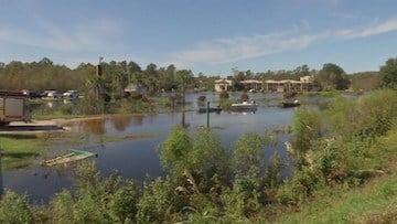 Parts of Marion County are flooded and can only be reached by boat.