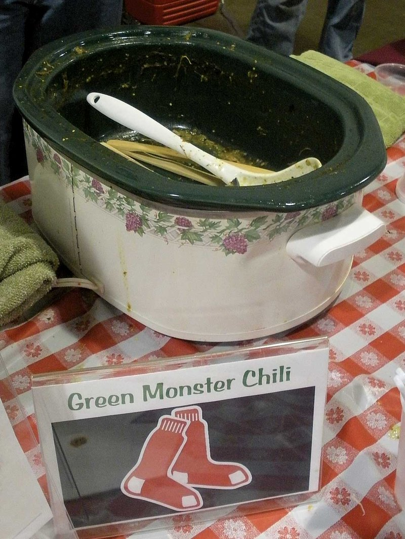 """James and Kimberly Keaveny's """"Green Monster Chili"""" won the crowd favorite trophy, which came as no surprise as the team served all five gallons of the popular recipe before the winners were announced."""