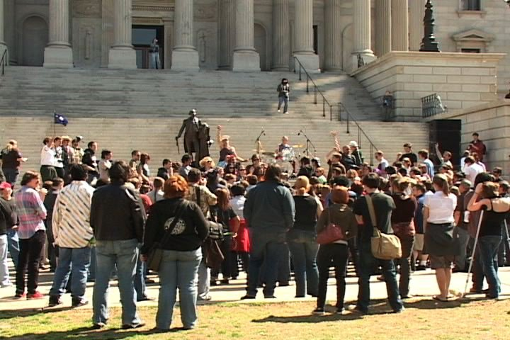 The rally brought in over 200 people to the Statehouse steps.