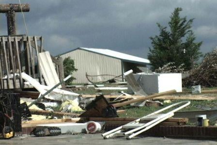Many of the items in the Amick's garage were strewn across the yard after Sunday night's tornadoes