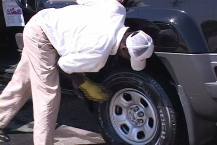A Frank's Car Wash employee puts the finishing touches on a pollen-free car.