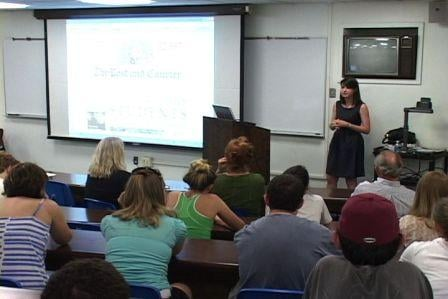 Diette Courrege spoke to a USC journalism class about investigative reporting after being presented the award.