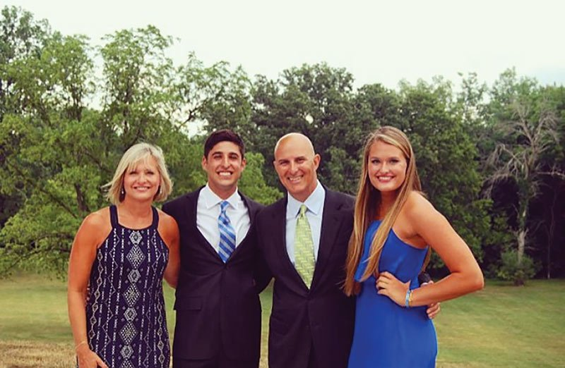 Allegra Marino (far right) stands next to her late father Joe Marino in a family photo taken the summer of 2014. When the picture was taken, Marino's faher was in remission. Marino says she's thankful she got more time with him.
