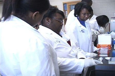Students working in a science lab at Allen University will benefit from the research money.