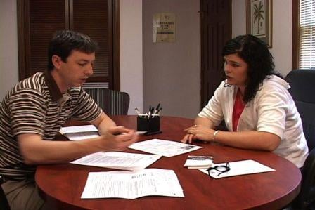 Jessica and Jason King go over the paper work for her soon-to-be new home.