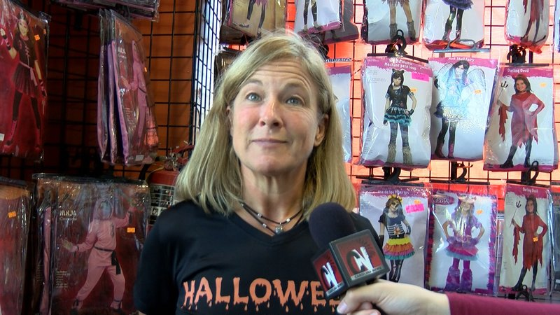 Libya Bentz says people consider the clown costumes at her store, but most walk away with another outfit to wear.