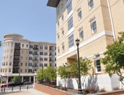 The Honors Residence Hall, which opened in August, stands across from the Adesso condominium building.