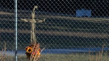 This cross sits on the front fence of the property in memory of all the lives lost.