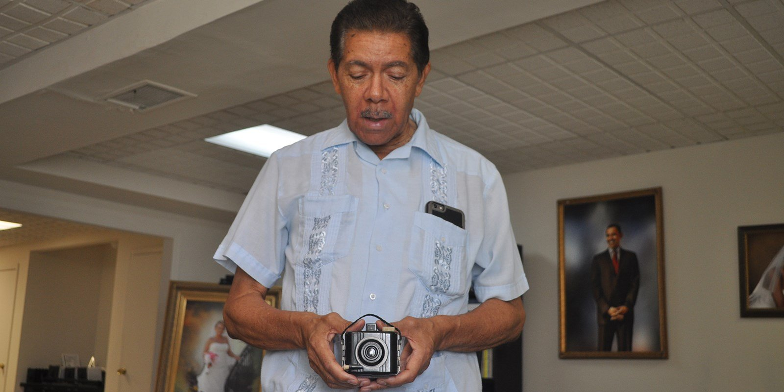 Cecil Williams in Nov. 2016 showing off his first camera - a Kodak Baby Brownie.
