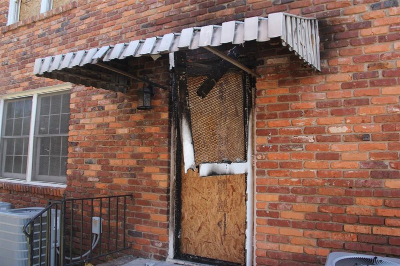 Officials believe that the fire was started in this rear stairwell of the brick building.