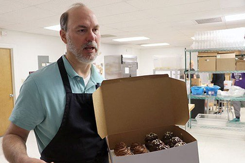 Jon Rogers, the owner of Chocolate Nirvana, has his full staff on hand fulfilling the flood of requests for romantic treats. The current best-seller is the Godiva Cupcake, which is dipped into chocolate ganache after being frosted.