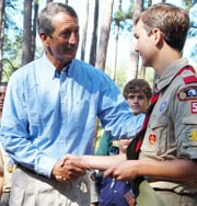 "Gov. Mark Sanford presents the first ""Scout Carolina"" patch to Life Scout Drew Moore."