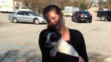 Sara Williams shows her new puppy Nafa.