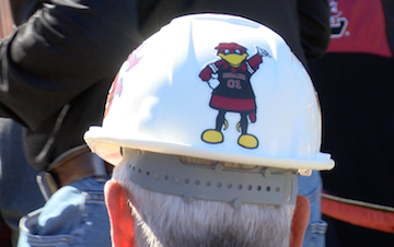 """Fans were given hard  hats in honor of Bill """"Oot Oot"""" Golding."""