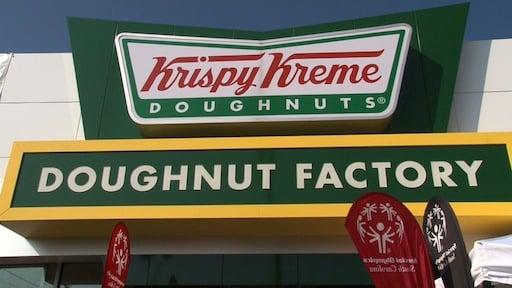 Cops raise money by sitting on top of Krispy Kreme.