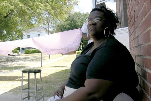 Suzette Weathers sits outside her Gonzales Gardens home off Forest Drive.  She says she's heard of the country's bedbug problem and hopes she doesn't get them because she knows she can't afford the treatment, which can cost over $1,000