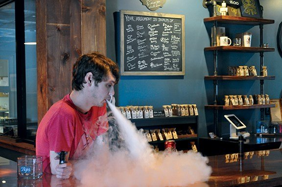Daniel Shealy, employee, enjoys one of Octopus' signature vapor flavors. Vaping has been on the rise for the last five years and there are at least 17 vape shops in Columbia, South Carolina.