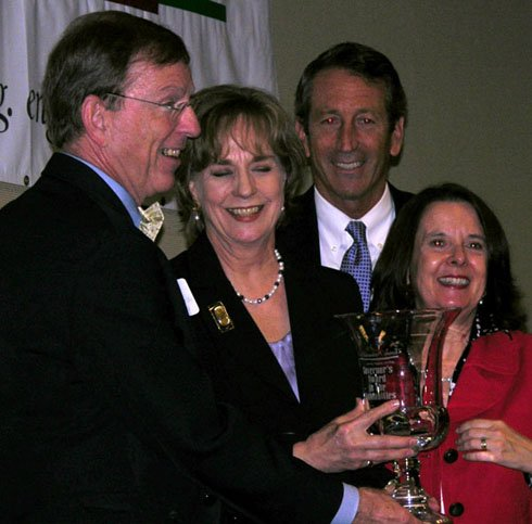 Lynn Robertson, executive director of McKissick Museum, stands center and receives her Governor's Award in the Humanities from Gov. Mark Sanford, right, USC Carolina Trustee Professor Walter Edgar, and Humanities Council Chairwoman Judy Burke Bynum