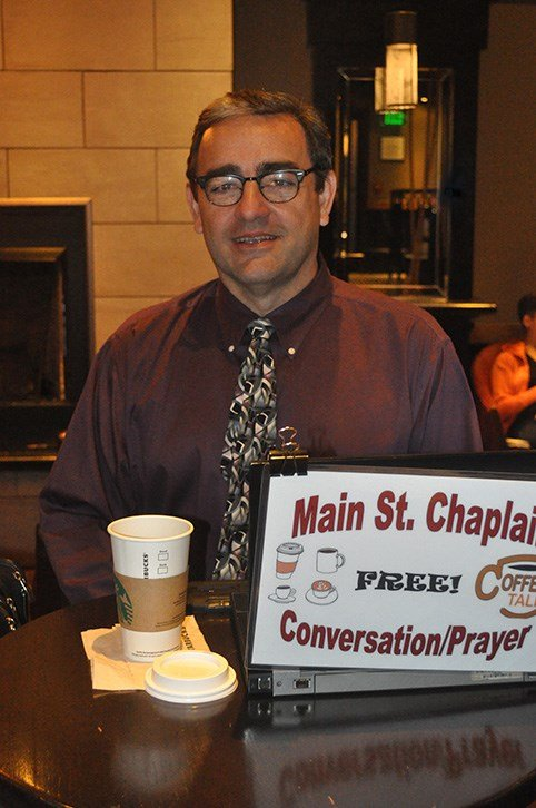 """Robert Walker is a pastor at Main Street Methodist Church and spends an hour each day making himself available to the public as the """"Main St. Chaplain."""" He believes that the U.S. should provide shelter for refugees nutil they can return home."""