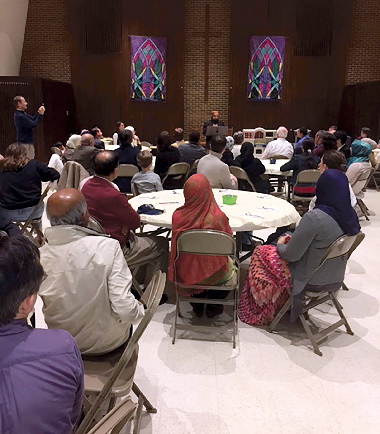 """Members of McGregor Presbyterian Church and Masjid Noor Ul-Huda mosque held a  """"Meeting of Two Faiths"""" potluck dinner. The two congregations helped settle Syrian refugees."""