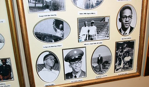 Willie Harriford's den is filled with family photographs including some black and white photos that follow his college career and his time in the military.