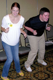 Katharine Stafford and Sam Roberts do the Tooty-Ta dance at Jones' Full-Belly Laughter presentation.