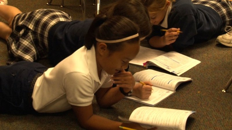 Kids studying at Saint John Neumann School